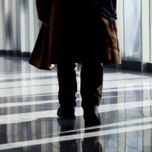 Man Walk Through Glass